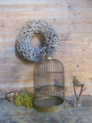 Oude koperen vogelkooi
