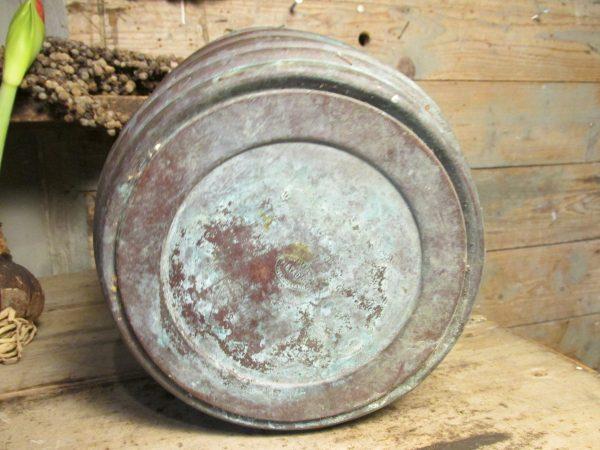 Oude koperen pot